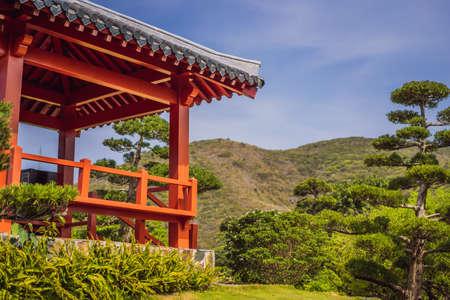 Japanese red gazebo in the Japanese garden