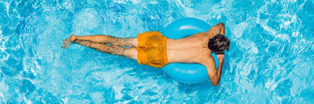 Young man swims in the pool, summer vacation concept BANNER, LONG FORMAT Zdjęcie Seryjne