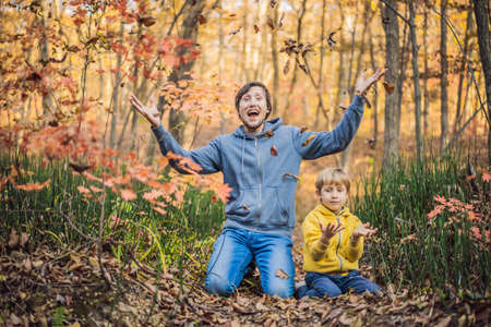 Happy smiling family relaxing in autumn forest Zdjęcie Seryjne