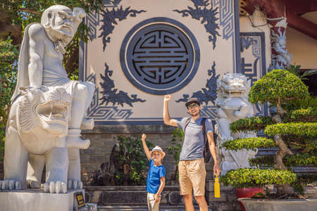 Dad and son tourists in Chua Linh Ung Bai But Temple, Lady Buddha Temple in Da Nang, Vietnam. Traveling with children concept