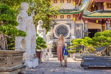Mother and son tourists in Chua Linh Ung Bai But Temple, Lady Buddha Temple in Da Nang, Vietnam. Traveling with children concept 版權商用圖片