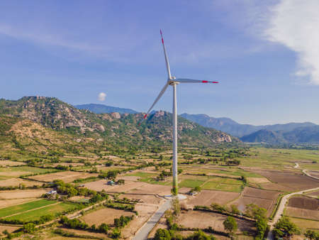 solar energy panels and wind turbine. Drone view