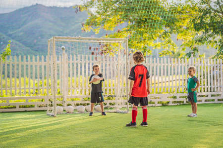 young boys playing football soccer game. Running players in uniforms