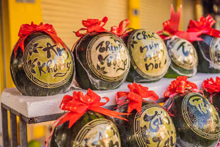 Water melons with festive engraving on Tet Eve. Tet is Lunar New Year and celebrated during four days in Vietnam