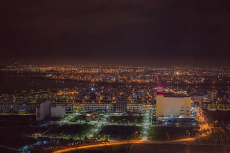 The architecture shimmering under the night-lit city makes the city more vibrant in Da Nang, Vietnam