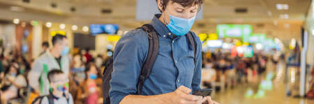 Man traveler with medical face mask to protection the coronavirus in airport BANNER, LONG FORMAT