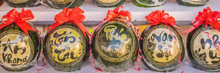 BANNER, LONG FORMAT Water melons with festive engraving on Tet Eve. Tet is Lunar New Year and celebrated during four days in Vietnam. TEXT TRANSLATION from Vietnamese: Congratulations on the Vietnamese, Chinese New Years and wishes of all the best in the New Lunar Year.