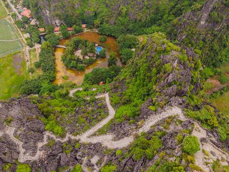 Top pagoda of Hang Mua temple, rice fields, Ninh Binh, Vietnam. Reklamní fotografie