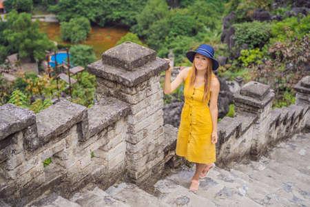 Woman tourist on top pagoda of Hang Mua temple, rice fields, Ninh Binh, Vietnam. Reklamní fotografie