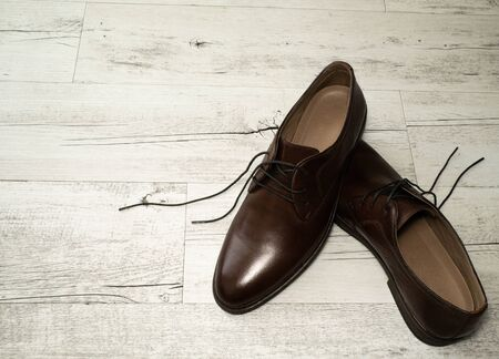 Mens brown classic shoes, background with mens shoes, man leather shoes
