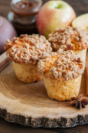 Apple cinnamon streusel muffins on a wooden board. Wooden background. Stock Photo