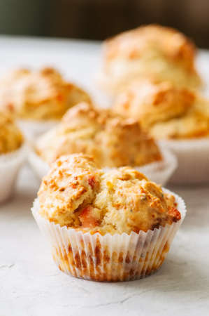Homemade savory muffins with fish and cheese on a white stone background. Healthy snack or breakfast meal. Stock Photo
