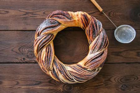 Chocolate swirl brioche wreath on a wooden background.