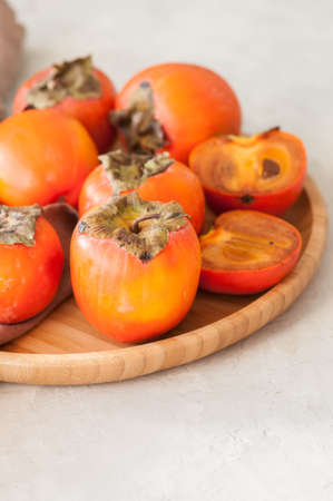 Plate of fresh and ripe persimmons. Close up. 스톡 콘텐츠