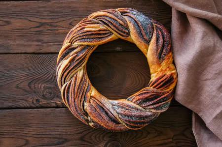 Chocolate swirl brioche wreath on a wooden background