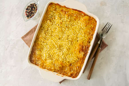 Shepherds pie -  Irish traditional food. Served in a ceramic dish on a white stone background. Stock Photo