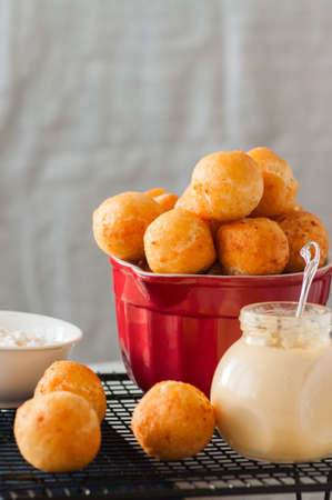 Small cottage cheese doughnuts (castgnole) served on a wire rack. Stock Photo - 92298227