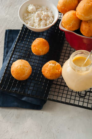 Small cottage cheese doughnuts (castgnole) served on a wire rack.