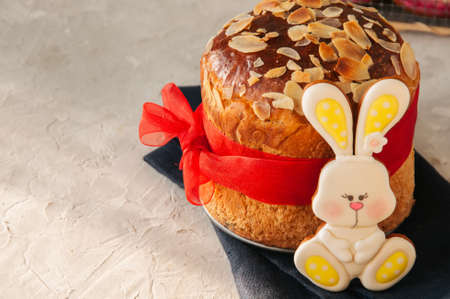 Easter orthodox sweet bread, cottage cheese kulich and colorful bunny and eggs cookies.