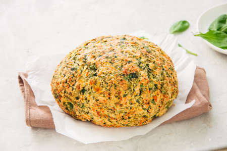 Freshly baked cheesy spinach bread on a white stone backdrop. Rustic style.