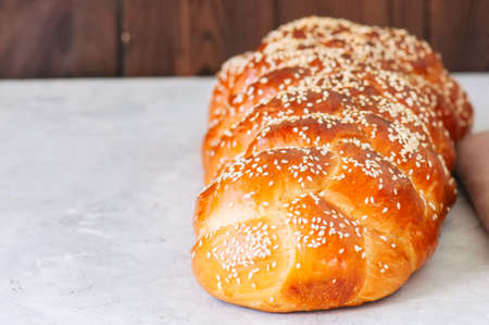 Traditional Challah Bread on a white stone background. Close up.