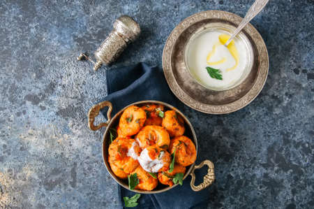Traditional Turkish food - fellah koftes, polpettes from bulgur and semolina in tomato sauce with parsley and ayran. Middle eastern food concept. Stock Photo