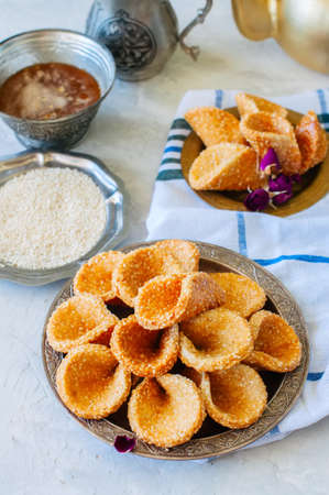 Honey and sesame babouches - popular arabic dessert. Arabic and middle eastern food concept Stock Photo