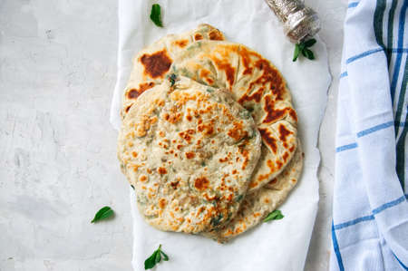 Indian flatbread - Herb stuffed paratha on a baking paper