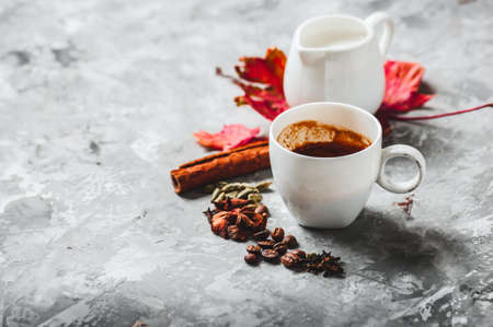 Cup of espresso with milk and spices