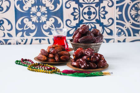 Assorted dried dates or kurma in a vintage plates and tea Stock Photo