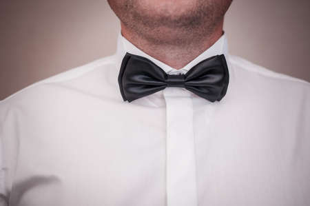 Dark black bowtie on the grooms neck