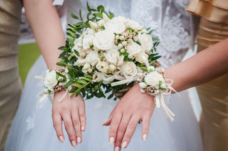 Bouquets of flowers in the hands of the bride and bridesmaids Banco de Imagens