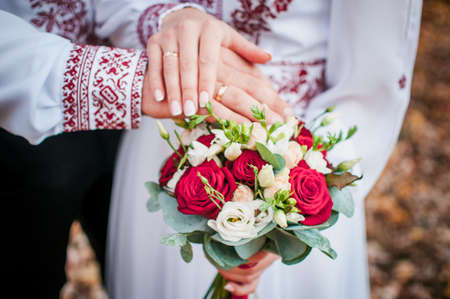 Bouquet of flowers in the hand of the bride and groom