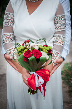 Colorfull flower bouquet of flowers in the hand of the bride