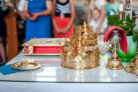Pair of golden crowns on the table in church