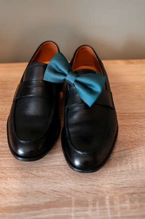 Black man shoes and tiebow