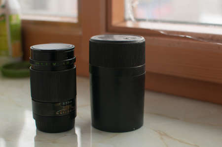 Old black manual lens with black case Stockfoto