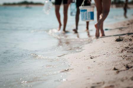 Sand beach sea coast and people on the background
