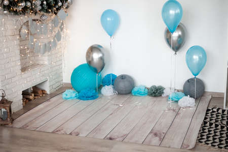 Grey and blue air balloons near the wall