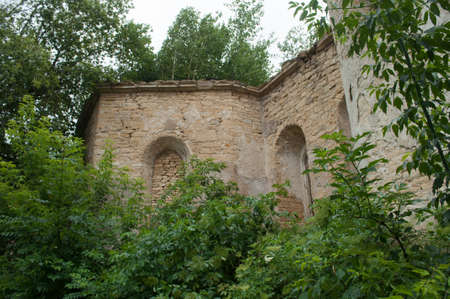 Walls of old abandoned ruined roman catholic church in the village Stockfoto