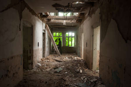 Dark shadow in the end of the hallway of abandoned hospital