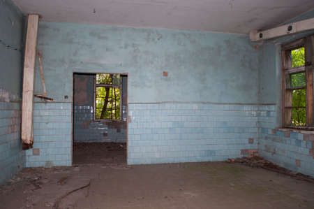 Blue room with the doorway and windows in the abandoned chemical laboratory