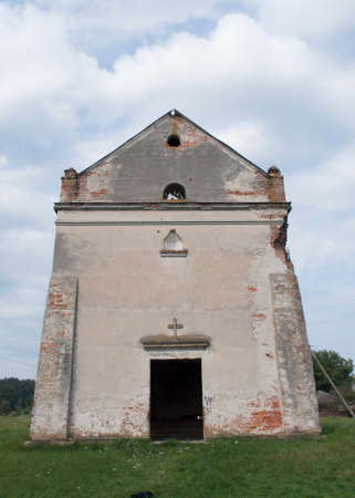 Old ruined abandoned church with open door