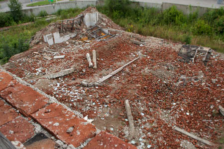Aerial view on the destroyed walls from brick