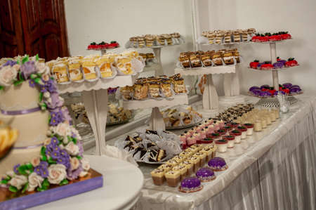 Sweet cakes at a wedding buffet. Catering