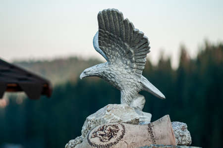 Stone statue of eagle in the outdoor space
