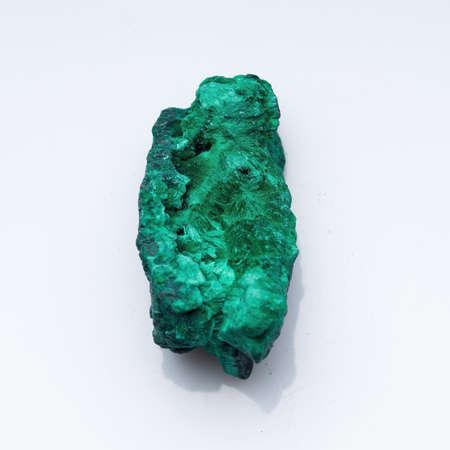 Malachite green ore on a white background. Natural green malachite