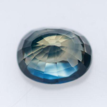 Natural blue sapphire on a white background Archivio Fotografico