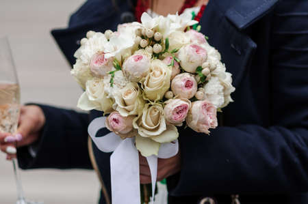 Bouquet of flowers in the groom's hand