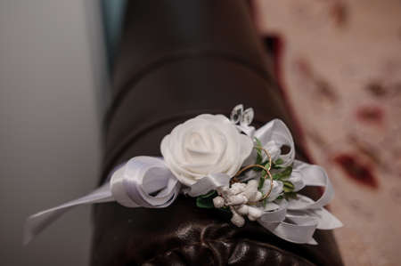 Groom boutonniere on brown background